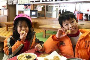 Enjoying a hot meal after skiing in Nozawa